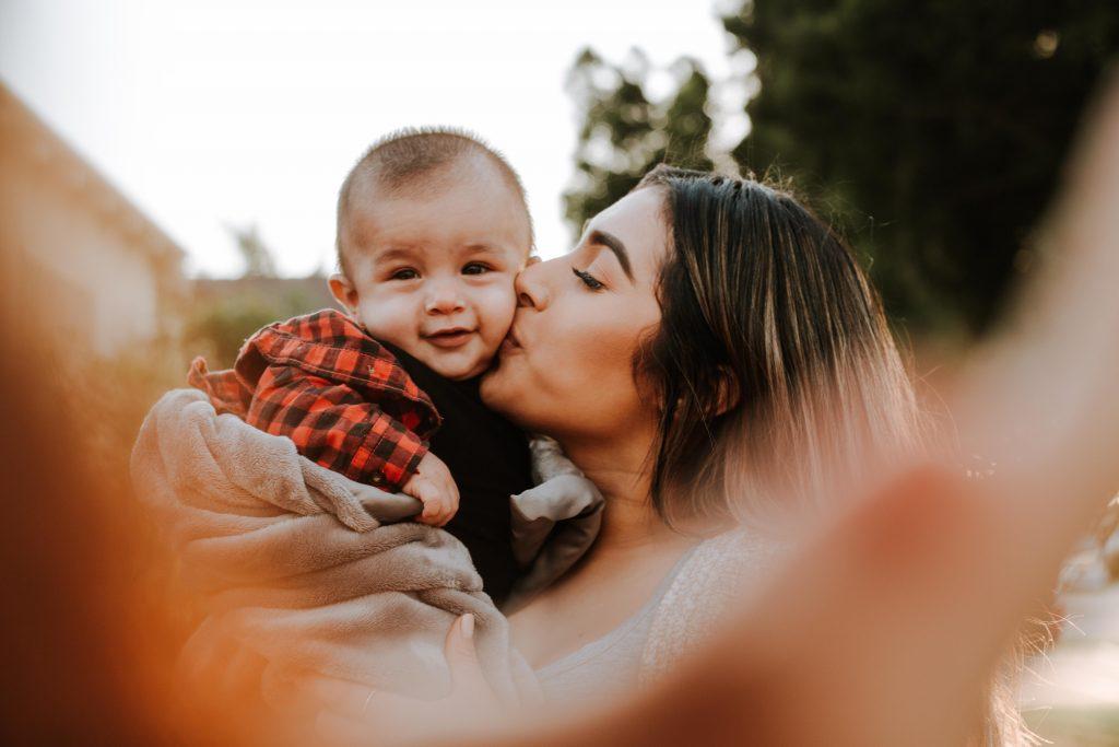 emergency babysitter kissing baby